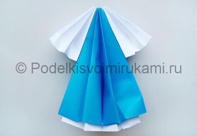 Как сделать куклу из бумаги. Фото 17.