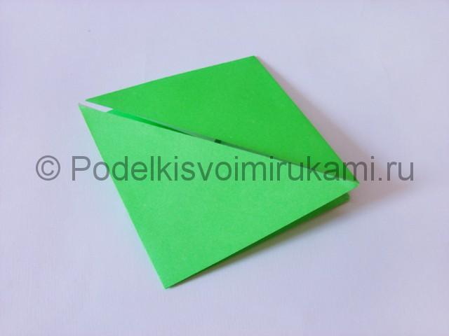 Как сделать прыгающую лягушку из бумаги. Фото 11.